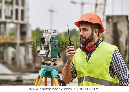 Stock photo: male worker using a talkie walkie