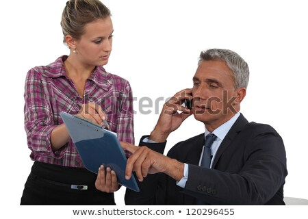 Man making a business call with the help of his secretary Stock photo © photography33
