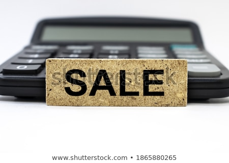 Businessman working with a calculator against a white background stock photo © wavebreak_media