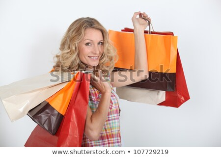 A smiling woman who enjoyed a shopping spree. Stock photo © photography33