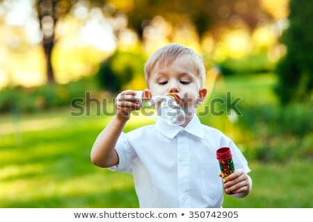 Young Boy Blowing Bubbles Stock photo © iofoto