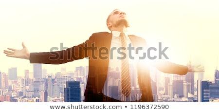 Działalności wolności biznesmen siedzieć rock otwarte Zdjęcia stock © elwynn