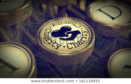 Charity Typewriter Key. Grunge Background. Stock photo © tashatuvango