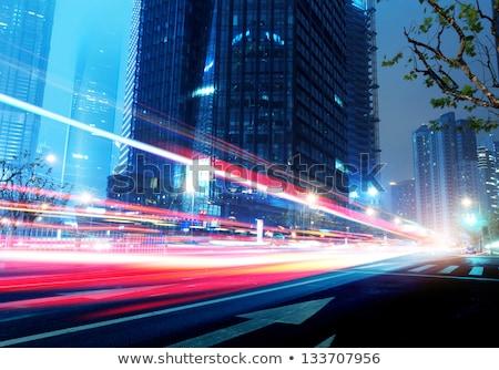 пешеходный мост ночь движущихся автомобилей автомобилей здании Сток-фото © kawing921