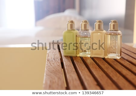 Négy kozmetikai üvegek illemhely parfüm szárított növénygyűjtemény Stock fotó © hd_premium_shots