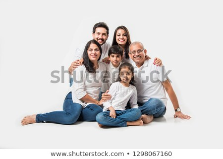 Young cute boy in focus with family in the background stock photo © get4net