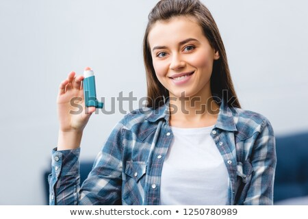 young woman holding asthma inhaler stock photo © evgenyatamanenko