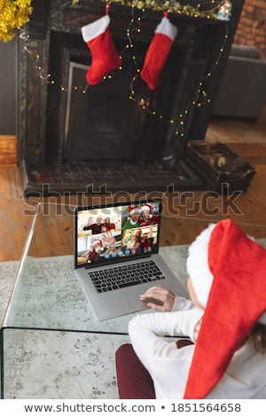 Stock photo: Seniors at home in front of fireplace