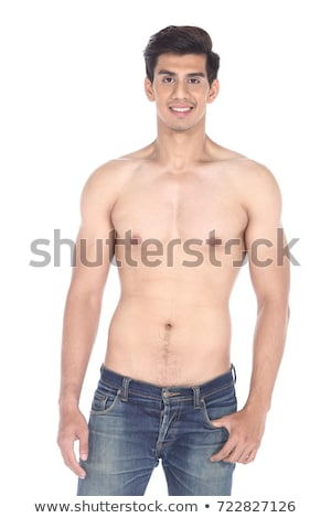 Muscled male model posing in studio on a light background Stock photo © pxhidalgo