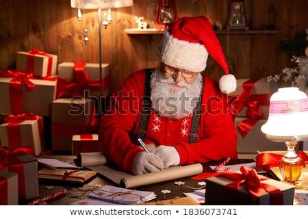 Mikulás ül otthon ír levél régi papír Stock fotó © HASLOO