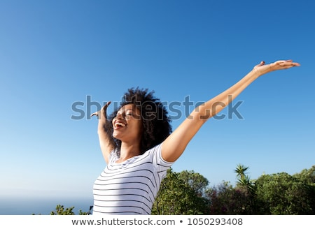 Stock photo: Woman and blue sky