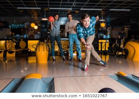 Sorridere giovane giocare palla da bowling sport uomini Foto d'archivio © Jasminko