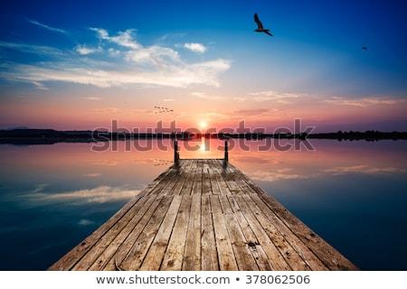 закат док озеро старые лодка запуск Сток-фото © jackethead
