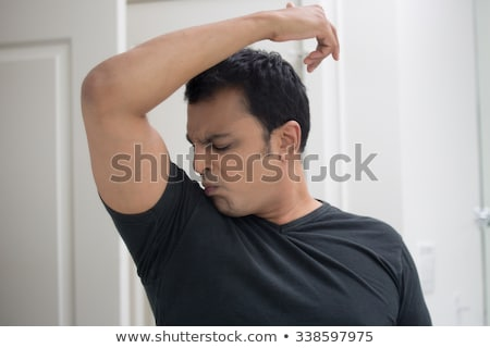 man smelling himself Stock photo © ichiosea