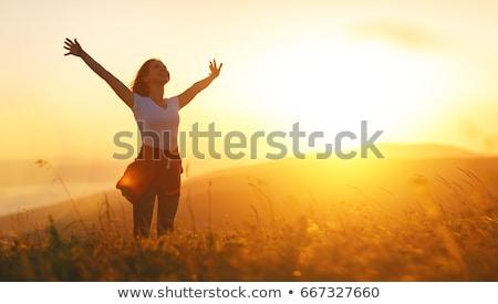 happy woman enjoying sun on the beach stock photo © yaruta