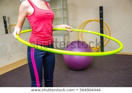 Woman doing exercises with hula hoop Stock photo © Elnur