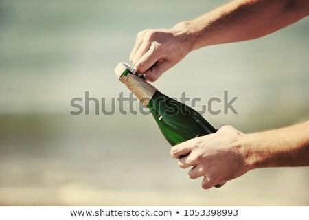 Открытая бутылка шампанского Сток-фото © dotshock