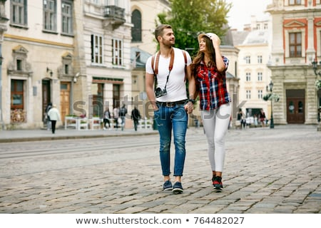 young beautiful couple tourists in old city stock photo © nejron