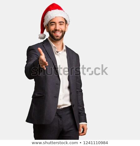 ビジネスマン 着用 サンタクロース 帽子 笑みを浮かべて 肖像 ストックフォト © bmonteny