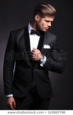 elegant man in tuxedo looking away from the camera  Stock photo © feedough