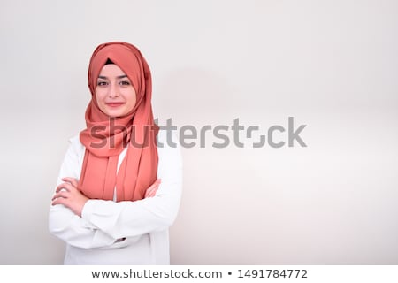 pretty woman with folded arms stock photo © stockyimages