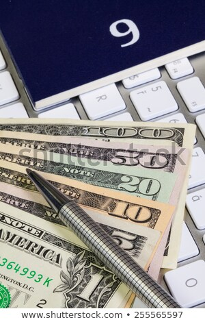 Business desk - Diary for September,US dollars,pen and keyboard Stock photo © CaptureLight