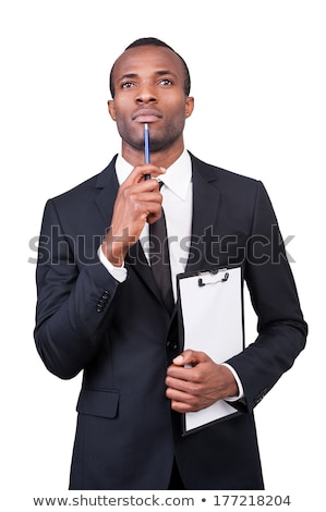 Thoughtful businessman in formalwear holding documents Stock photo © HASLOO