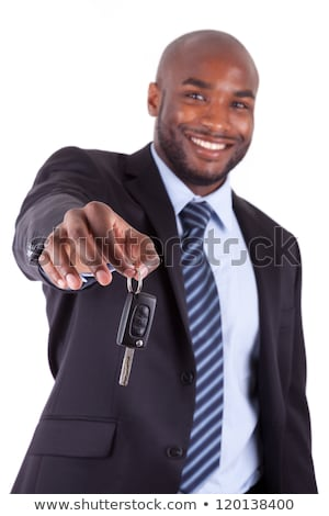 african american businessman holding a key stock photo © stockyimages