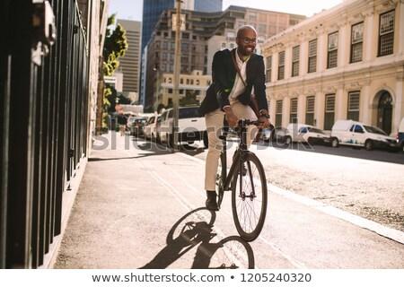 Black businessman on bike rides to work Stock photo © studiostoks