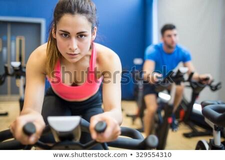 Determinado caber casal trabalhando exercer bicicletas Foto stock © wavebreak_media