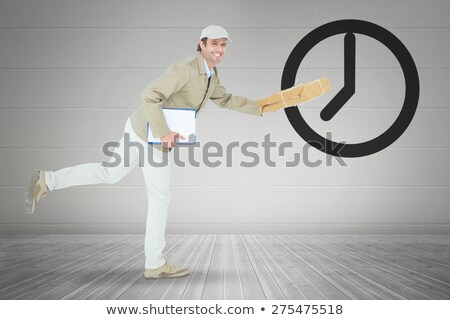 Happy delivery man running while holding parcel Stock photo © wavebreak_media