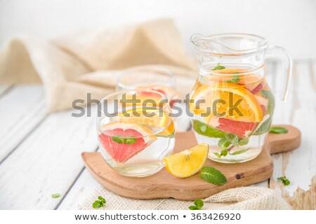 Pomelo agua limón bálsamo tazón Foto stock © maxsol7