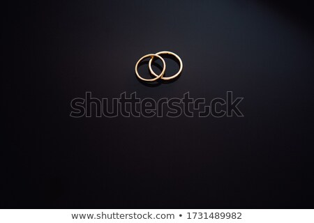 Studio shot of wedding couple, lying on the floor  Stock photo © konradbak