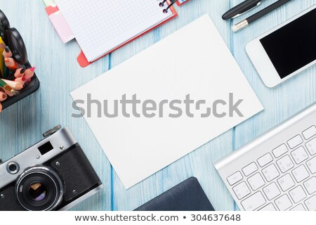 office desk with supplies camera and blank card stock photo © karandaev