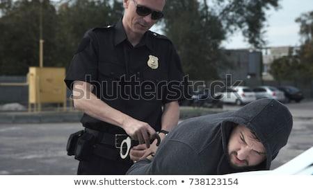 逮捕される · 手錠 · カバー · 顔 · 手 · 手 - ストックフォト © fotoedu