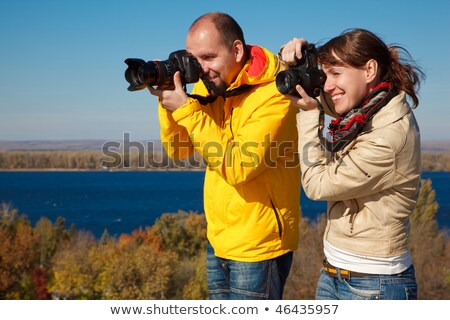 Man and girl photographed in nature. Lenses aimed at viewer. Stock photo © Paha_L