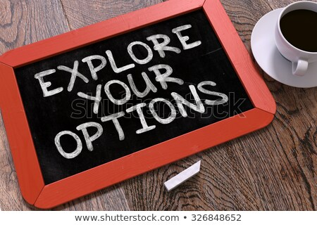 Explore Your Options. Motivational Quote on Chalkboard. Stock photo © tashatuvango