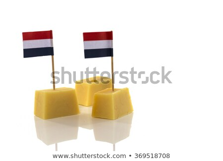 blocks of yellow dutch cheese with dutch flag in red white blue toothpicks on a white background stock photo © compuinfoto