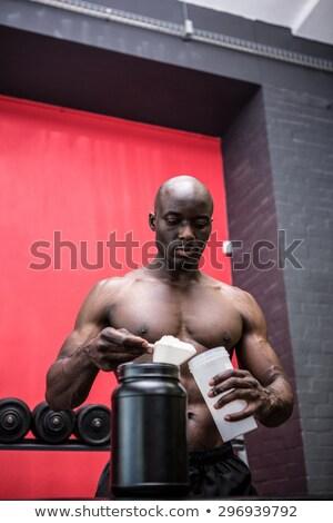 Genç vücut geliştirmeci doldurma şişe crossfit spor salonu Stok fotoğraf © wavebreak_media