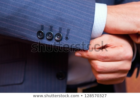 dressing. Closeup of a man in jacket correcting sleeves. Stock photo © traza