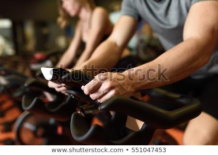 Man at Fitness Spinning on bike in gym Stock photo © Kzenon