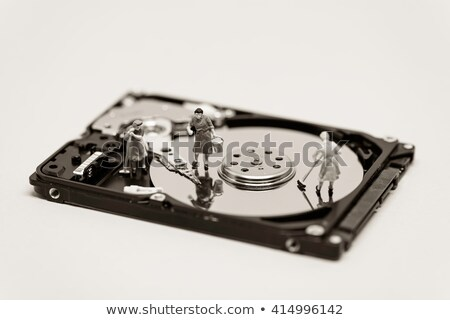 Women clean up a hard drive. Technology concept. Macro photo Stock photo © Kirill_M