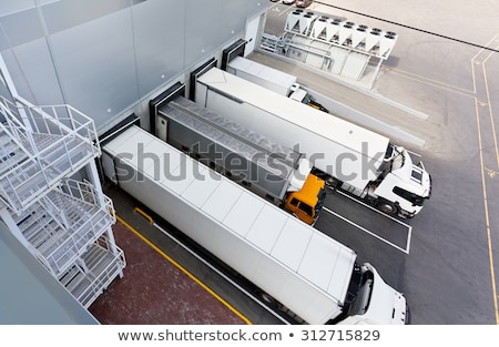 Big distribution warehouse with gates for loads and trucks Stock photo © nasonov
