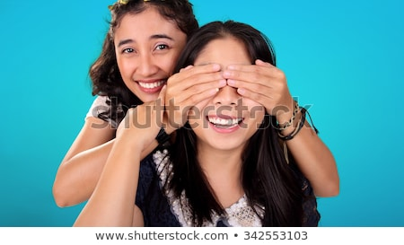 Girl closed her eyes hands friend. Guess who. Two girl friends Stock photo © orensila
