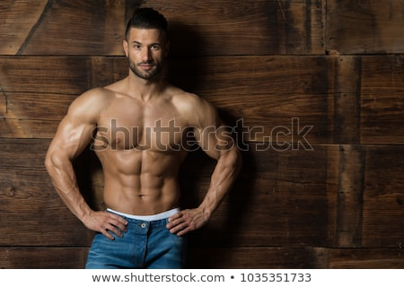 Handsome bodybuilder wearing jeans Stock photo © konradbak