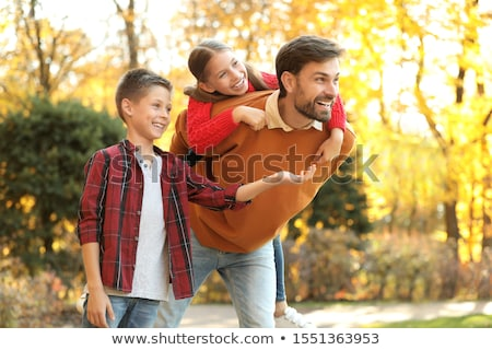 Boys and girls playing piggy back ride Stock photo © bluering