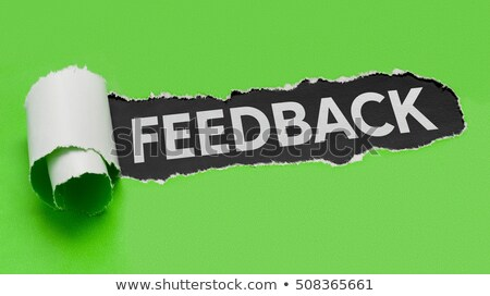 Stock photo: Torn green paper revealing the word Feedback