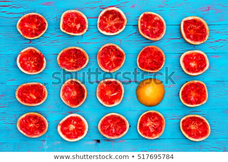 Five rows of ruby red grapefruit halves stock photo © ozgur