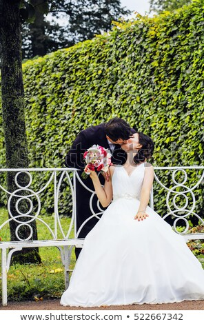 very beautiful bride with groom hugging and dancing in green park lifestyle real people concept stock photo © iordani