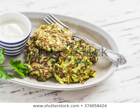 Salad with Fried zucchini on a wooden surface. Stock photo © user_11224430